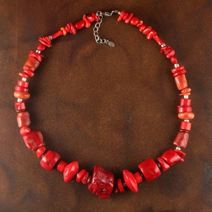 A bold red handmade coral necklace
