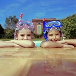 Kids swimming in a pool on vacation