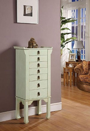 A stylish rustic green jewelry armoire