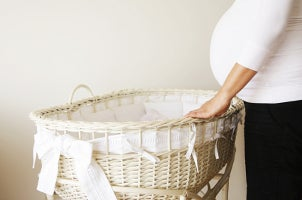 Green and white baby bassinet