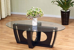 Circle glass coffee table with bouquet of flowers