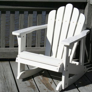 Childrenu0027s White Adirondack Chair On A Backyard Patio