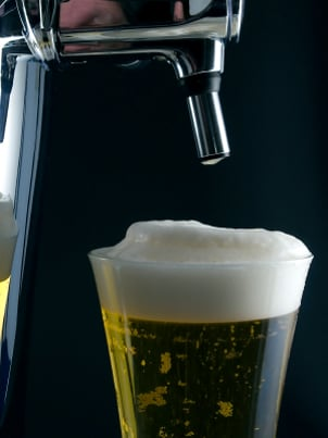A nice glass of cold beer recently poured from a home keg dispenser