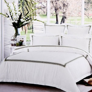 Crisp white hotel bedding