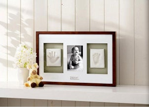 Cute baby picture frame keepsake gift sitting on a shelf