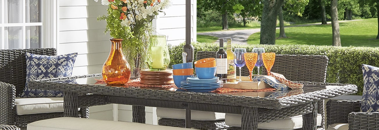 Wicker table with dish set outdoor dinnerware