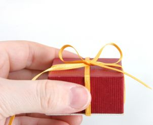A small red gift box containing Black Hills gold jewelry