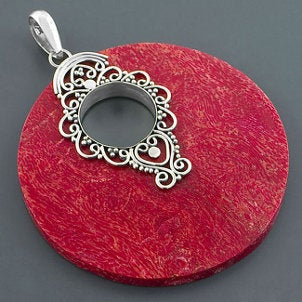 Red coral set in a silver pendant