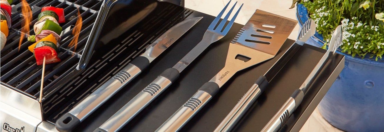 Grill with stainless steel utensils