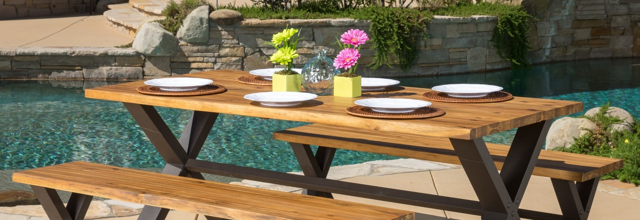 Wood picnic table with white plates
