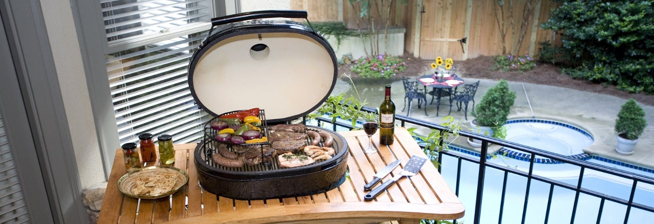 Black oval freestanding grill