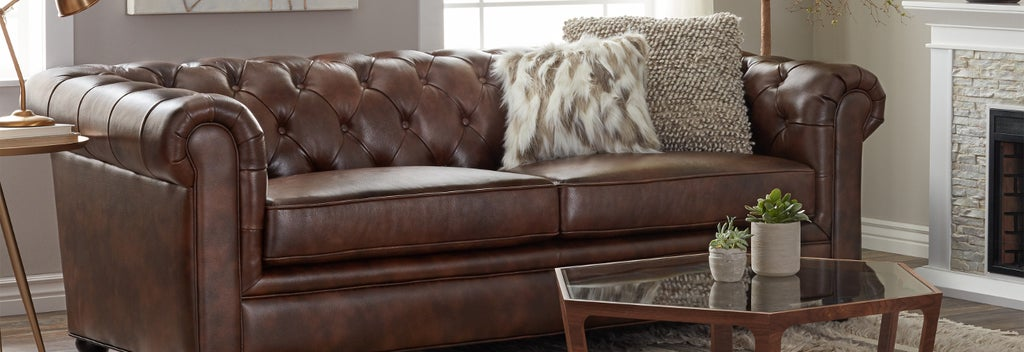 Leather couch in living room, a type of furniture