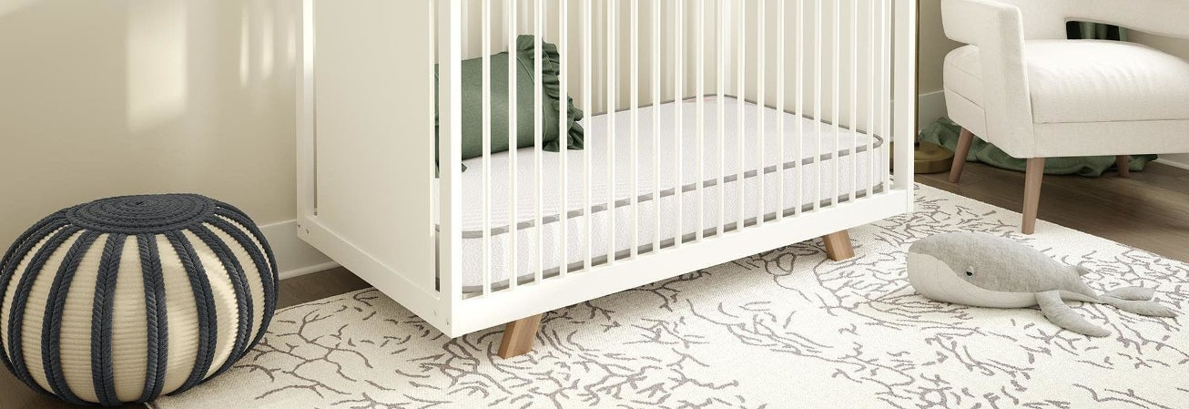 A crib with a crib mattress in it