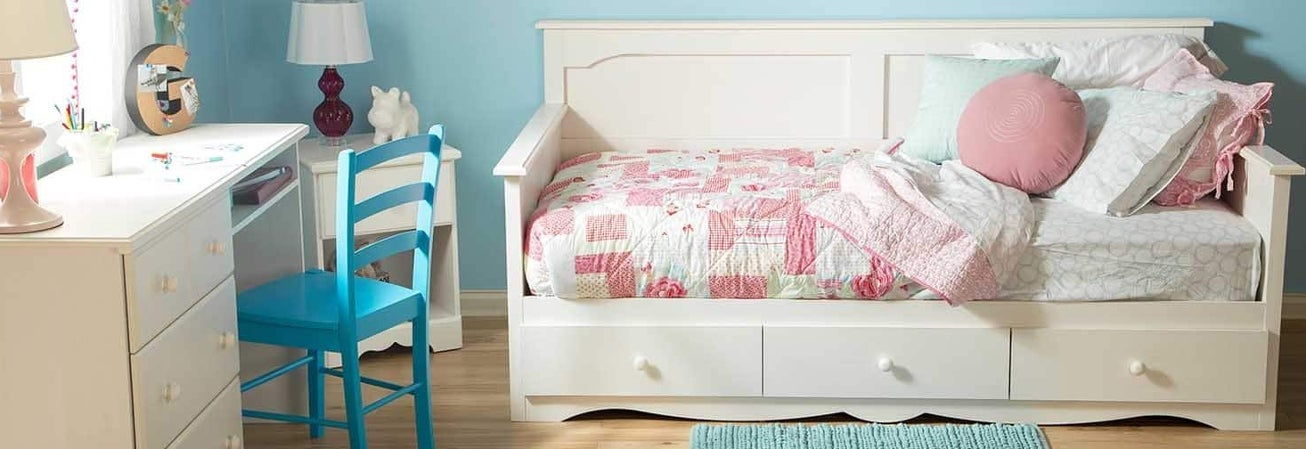 A kids bedroom featuring a kids bed
