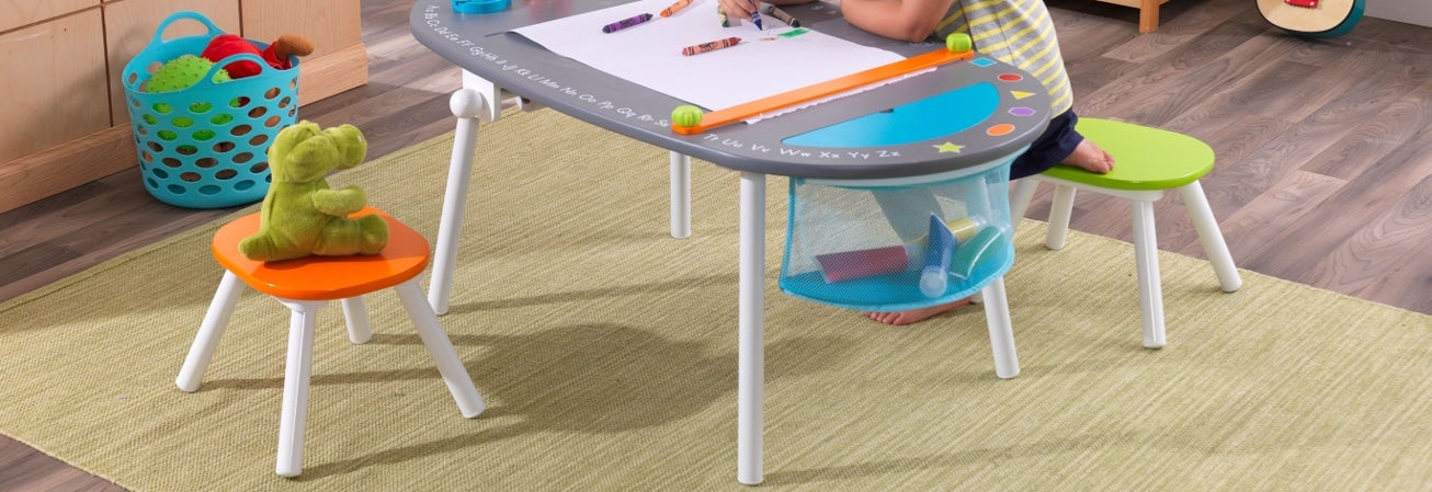 A kids table with chairs