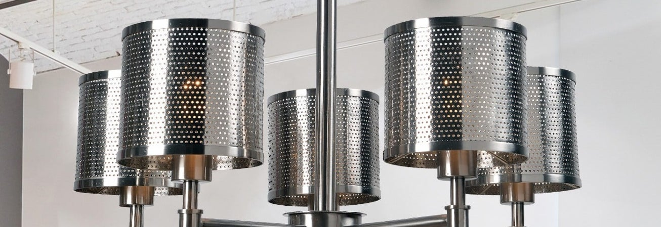 modern metal chandelier with perforated cylinder shades
