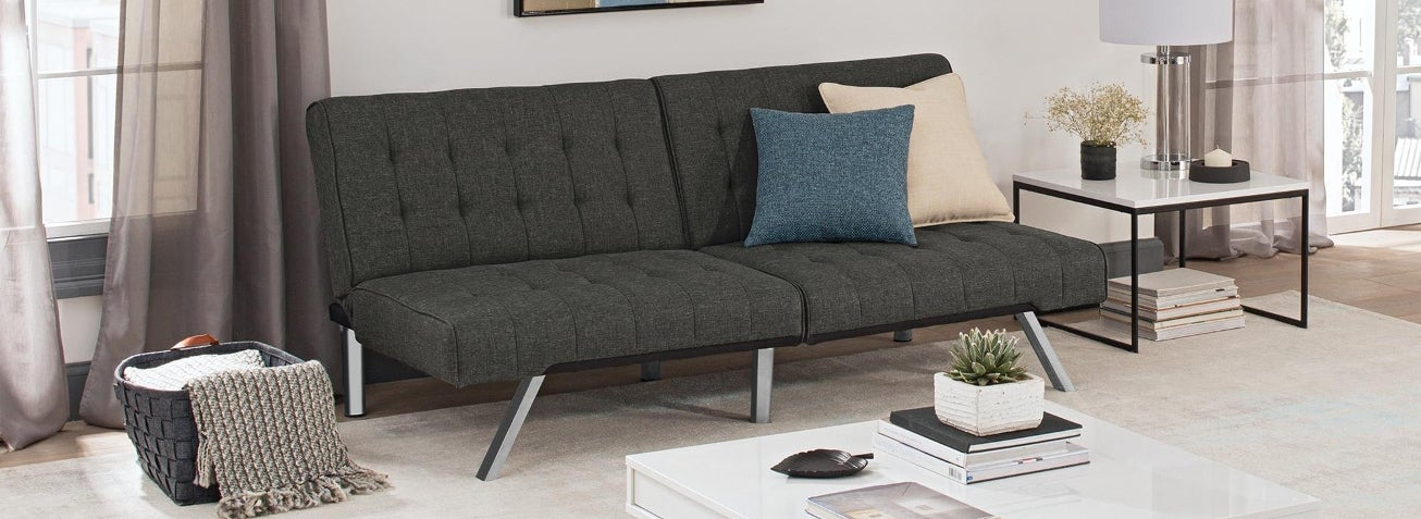 a futon in a living room futons for less   overstock    rh   overstock