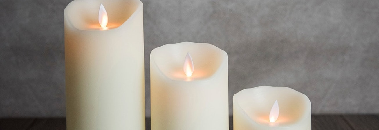 A set of three pillar candles