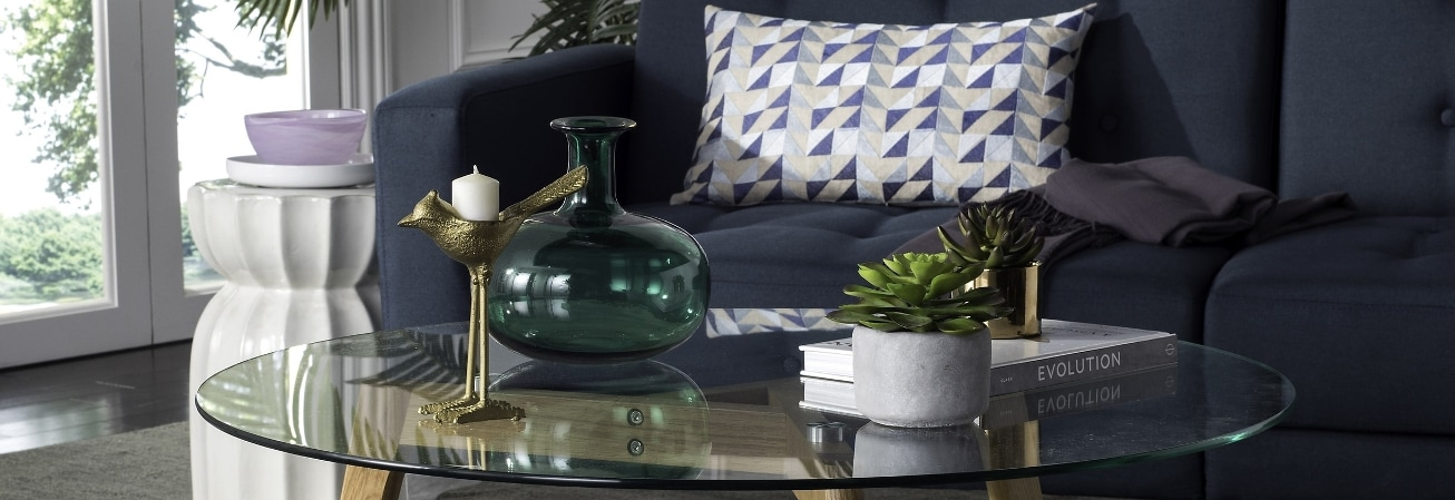 Navy sofa with glass coffee table
