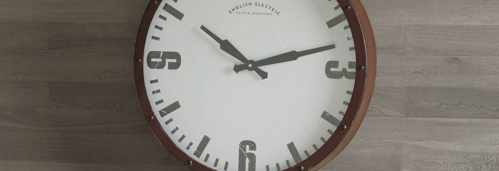 A trendy wall clock hanging on a wall