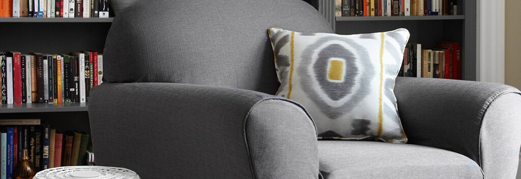 A grey slipcover on a chair