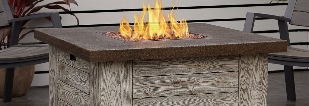 A stone fire pit outside on a patio