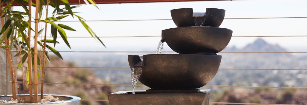 A beautiful outdoor fountain on a deck