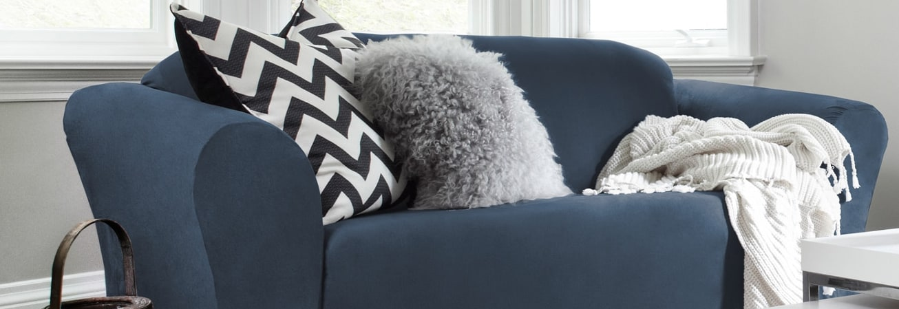 A blue stylish sofa and couch slipcover