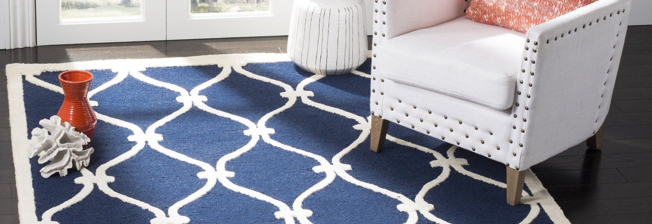 Navy Moroccan rug with white chair