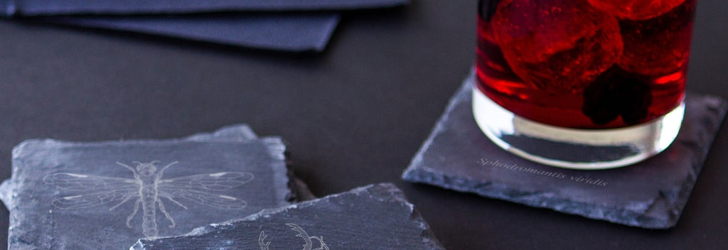 Slate coasters with drinking glass