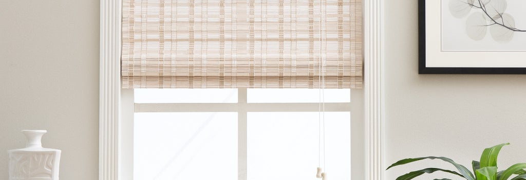 A set of blinds hanging on a window