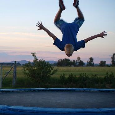 Boy doing a flip on a trampoline