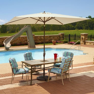 Poolside patio table with umbrela