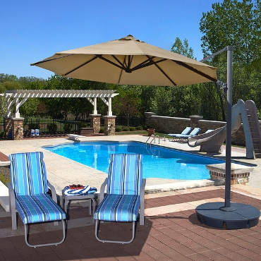 Poolside patio umbrella and chairs