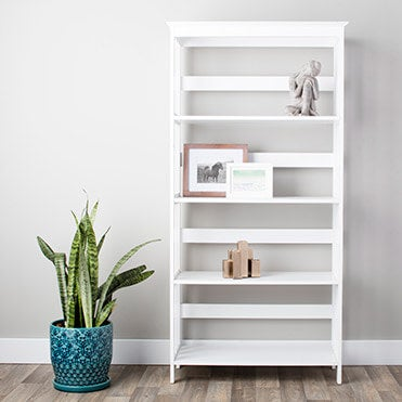 White bookcase featuring accent pieces