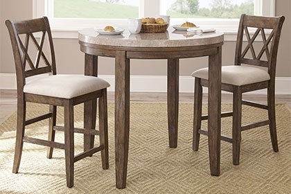 Dining and kitchen tables that totally work in small spaces for Small tall kitchen table