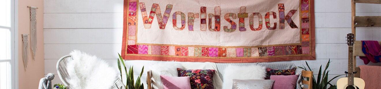 Worldstock quilt hanging in eclectic living room