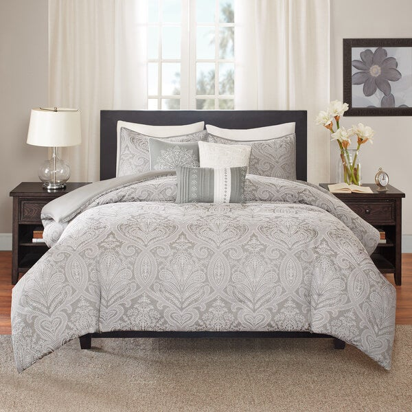 bed made with gray patterned duvet cover set