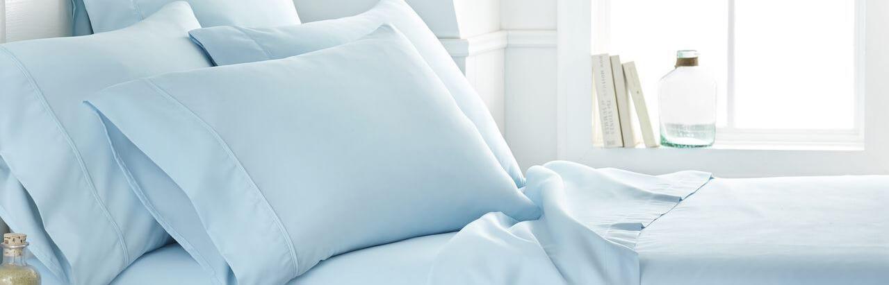 bed with light blue sheet set
