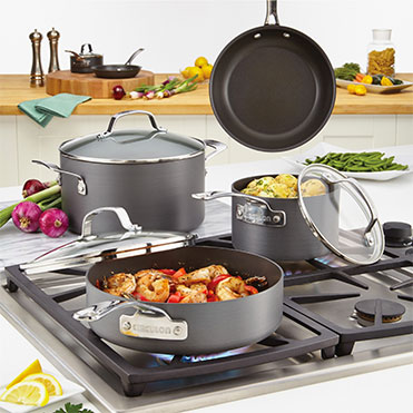 Anodized aluminum cookware set on stove top