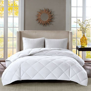 Down-alternative comforter on a bed