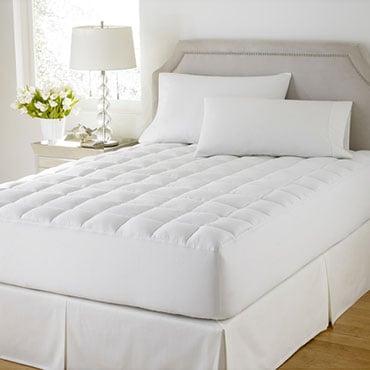 Mattress pad on a mattress with a bed skirt