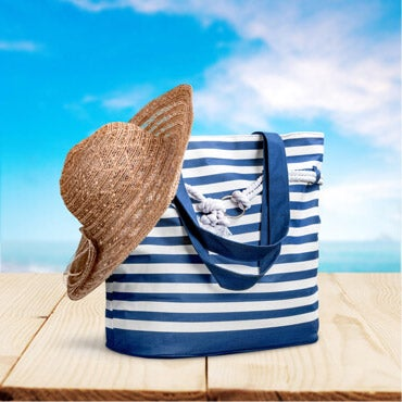 Blue and white striped tote bag with sun hat