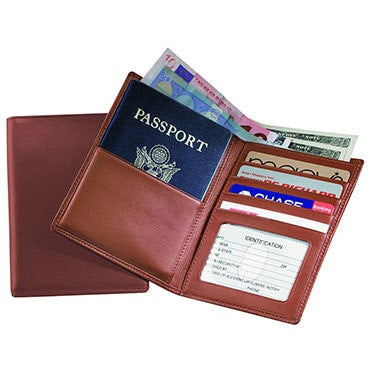 Travel wallet open to reveal passport, cash, and credit cards