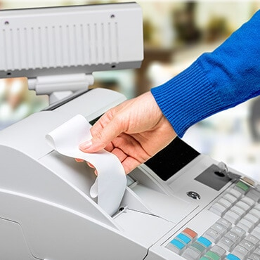 Cashier grabbing a receipt
