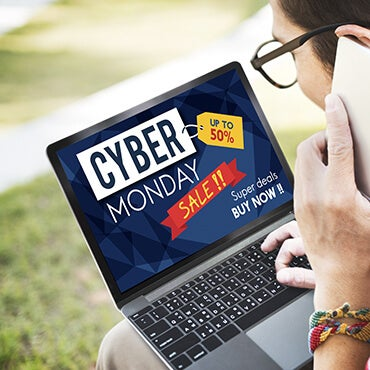 Man using laptop to look up Cyber Monday deals