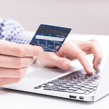 Man making an online purchase on his credit card