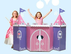 Two girls dressed as princesses playing in a pretend castle