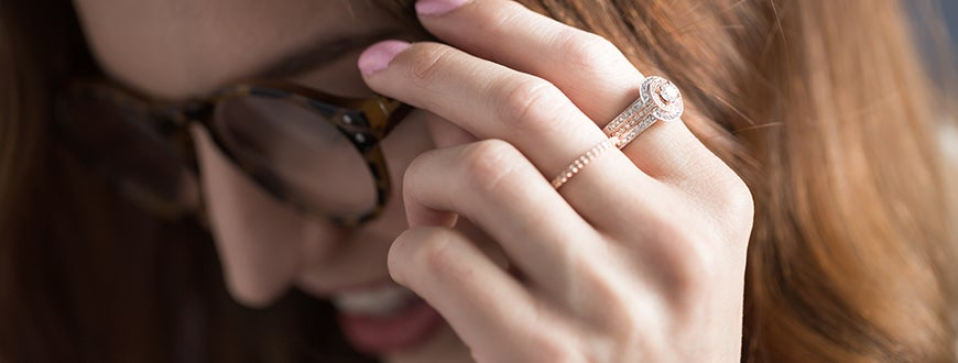 Woman adjusting her glasses wearing a diamond ring