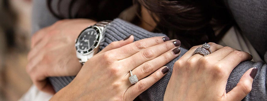 A closeup of a womans hands with diamonds on them